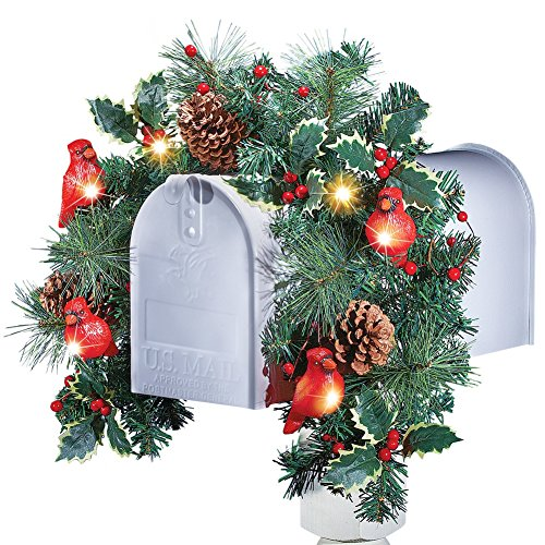 the colorful swag features greenery with holly berries pinecones and cardinals that automatically shine with solar powered light at night - Solar Powered Christmas Wreath